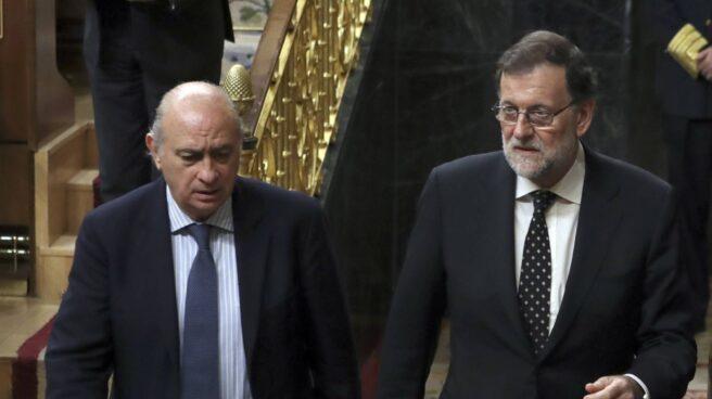 Jorge Fernández Díaz y Mariano Rajoy, en el Congreso.