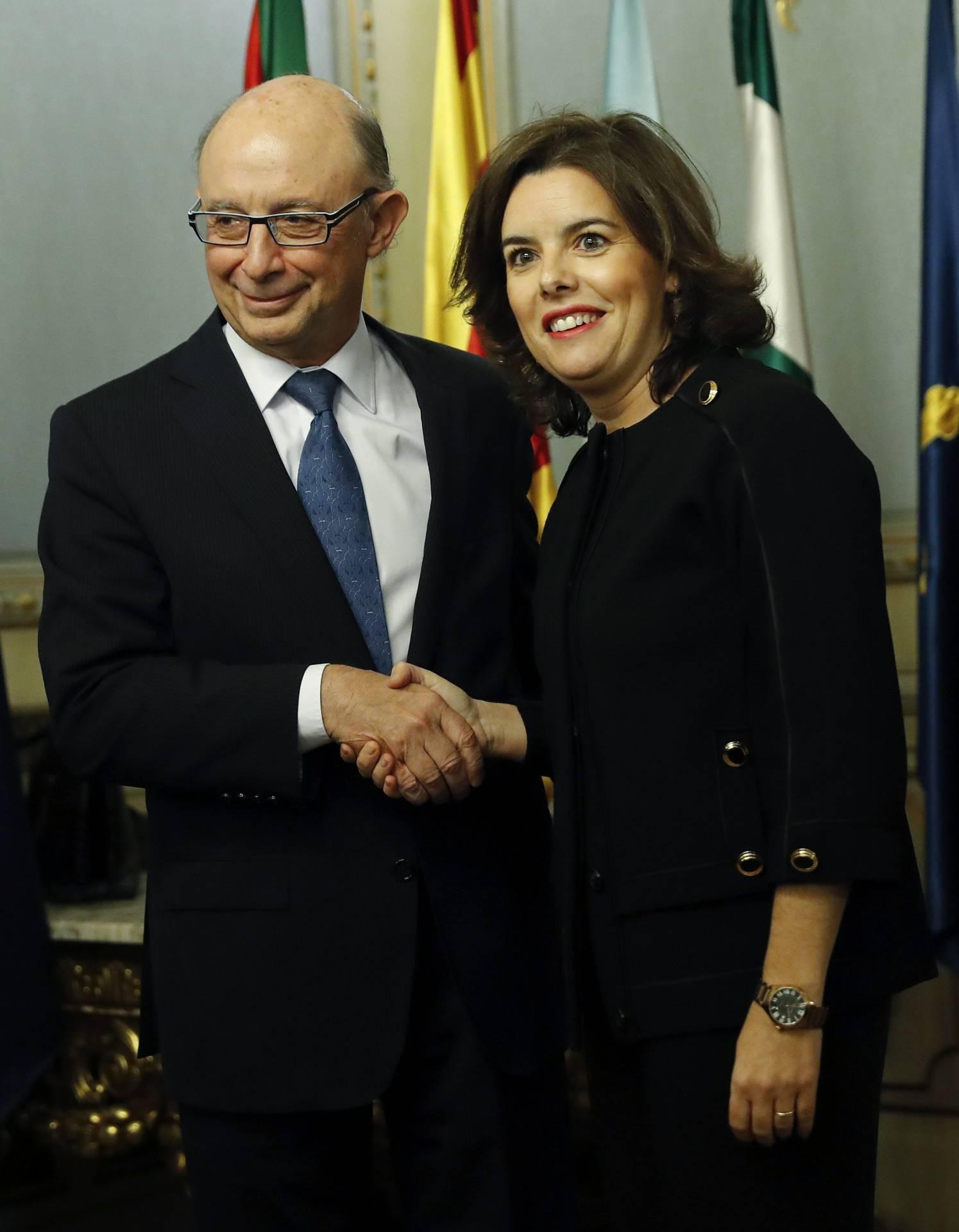 Cristóbal Montoro y Soraya Sáenz de Santamaría.