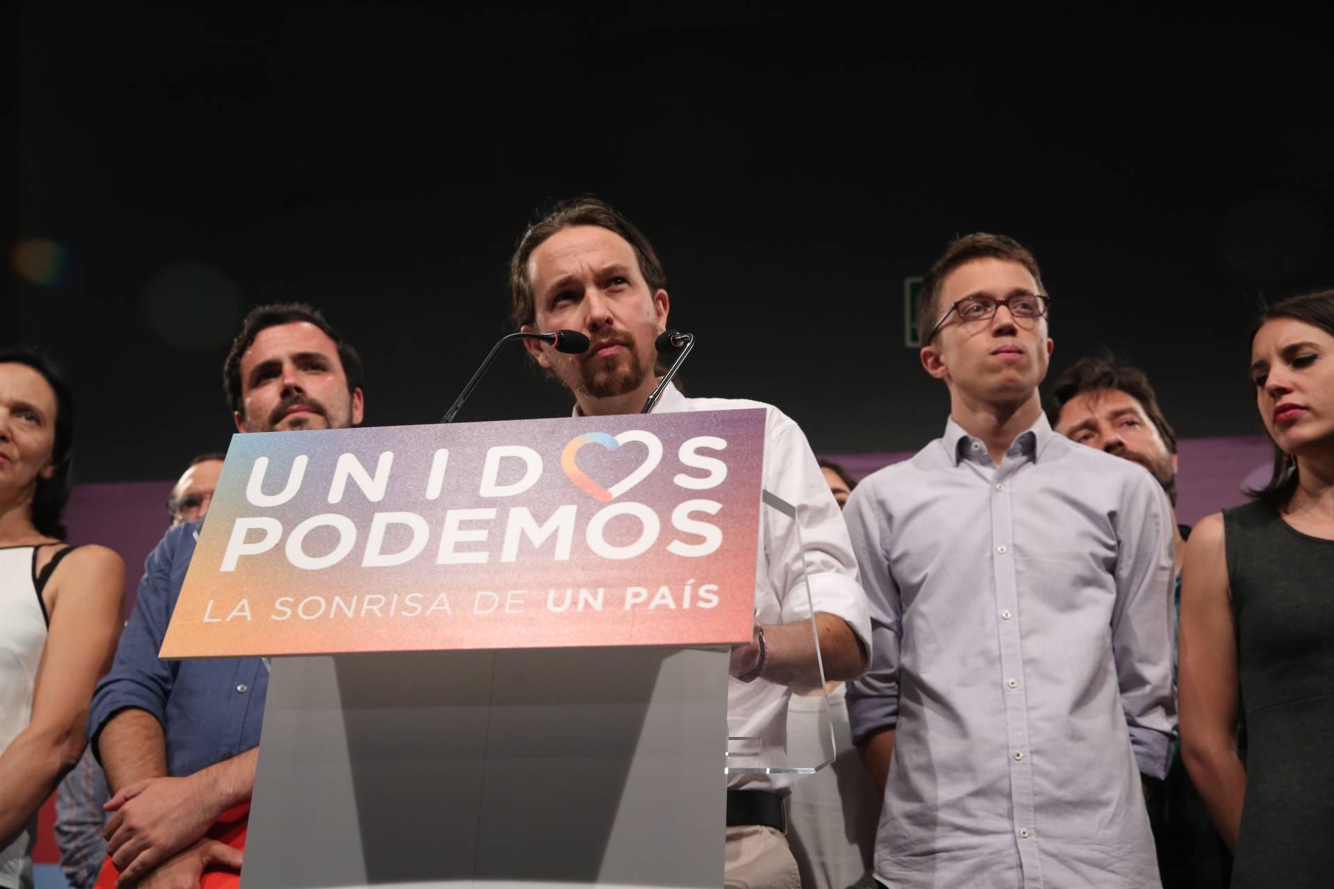 Alberto Garzón, Pablo Iglesias e Iñigo Errejón, en un acto de Podemos.
