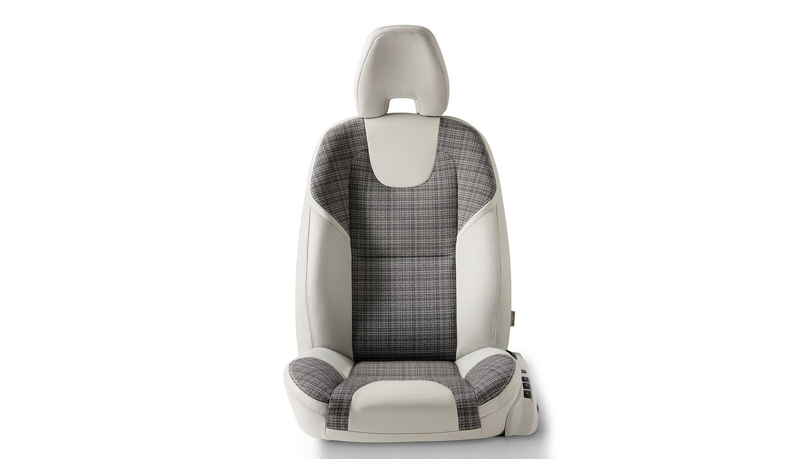 Inspirada en la del prototipo Volvo Concept Estate, la tapicería City Weave que estrena el Volvo V40 combina cuero beige con tela.