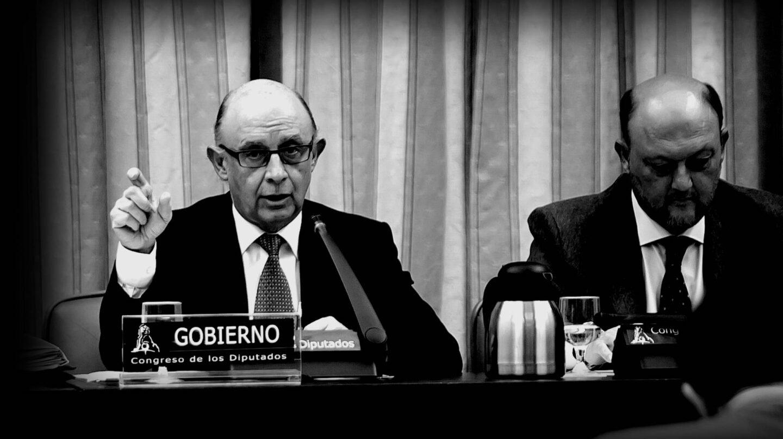Cristobal Montoro y Antonio Pradas.