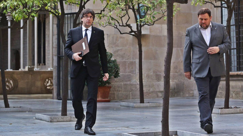 El presidente y el vicepresidente de la Generalitat de Cataluña, Carles Puigdemont y Oriol Junqueras.