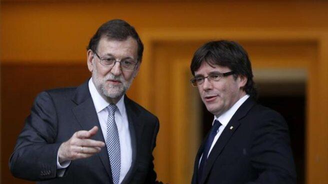 Rajoy recibió a Puigdemont en Moncloa en abrirl del año pasado