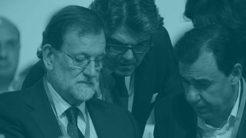 Mariano Rajoy, junto a Moragas y Maíllo.