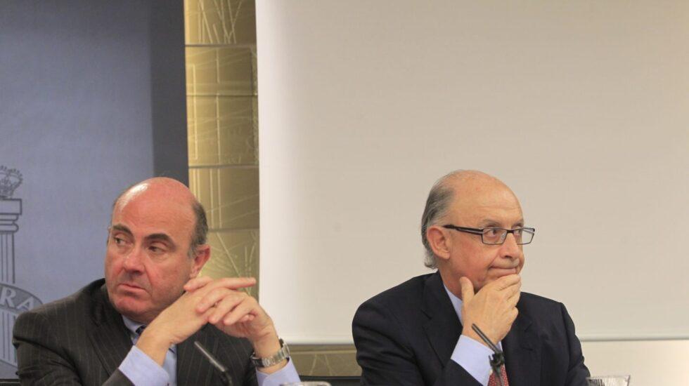 El ministro de Economía, Luis de Guindos, y el de Hacienda, Cristóbal Montoro.