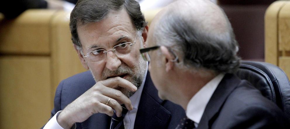 Mariano Rajoy y Cristóbal Montoro afrontan una votación de Presupuestos de infarto