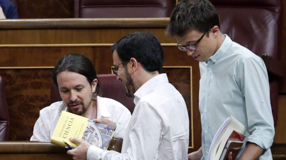 Pablo Iglesias, Alberto Garzón e Iñigo Errejón, en el Congreso de los Diputados.