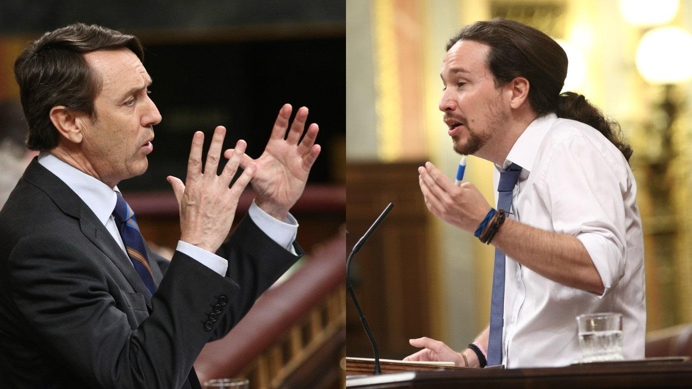 El portavoz parlamentario del PP, Rafael Hernando, y el líder de Podemos y candidato de la moción de censura, Pablo Iglesias.