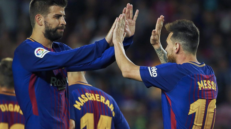 Piqué y Messi, en el Camp Nou.