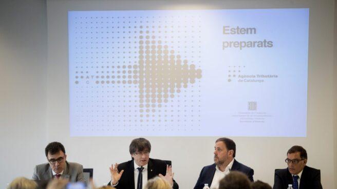 Puigdemont y Junqueras, en la Agencia Tributaria de Cataluña.