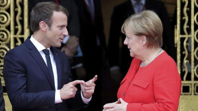 El presidente francés, Emmanuel Macron, y la canciller alemana, Angela Merkel, esta semana en la Feria de Fráncfort.