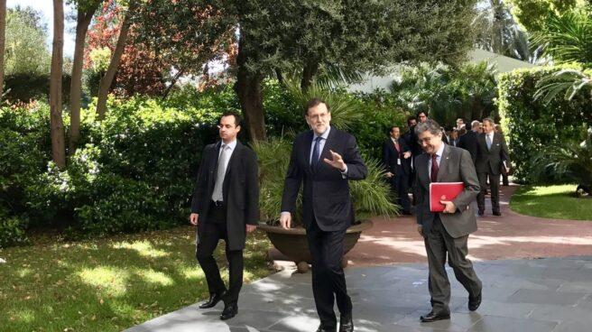 El presidente del Gobierno, Mariano Rajoy, junto al delegado del Gobierno en Cataluña, Enric Millo.