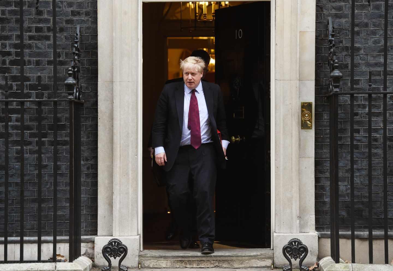 El ex ministro de Exteriores británico, Boris Johnson, tras una reunión con Theresa May.