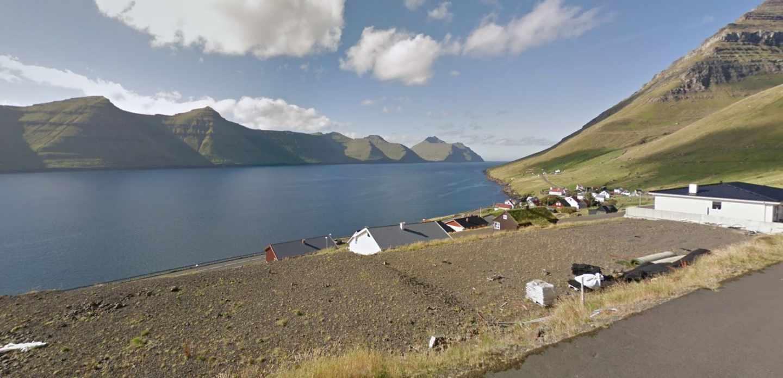 Población dispersa y paisajes de postal: la economía de las Islas Feroe depende al 95% de la pesca. En la foto, el poblado de Kunoy.