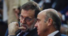 Rajoy y el todavía ministro de Economía, Luis de Guindos