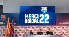 Eric Abidal y Sandro Rosell.