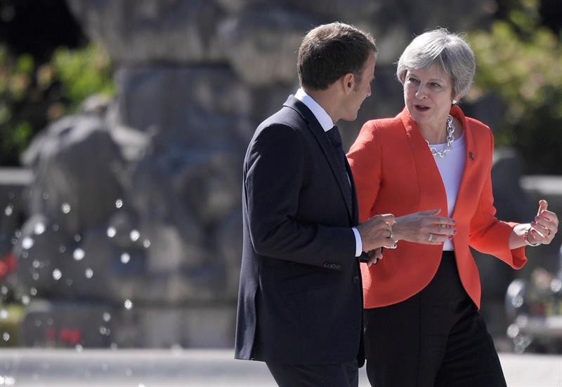 May y Macron en Salzburgo