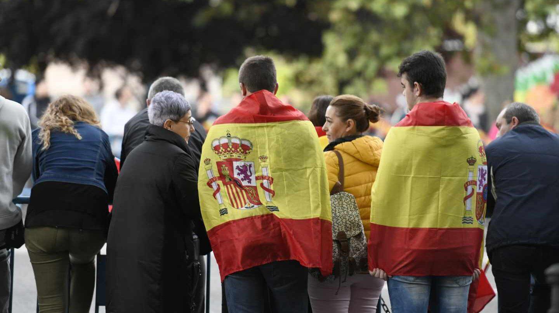 Asistentes al desfile del 12-O en la Castellana de Madrid.