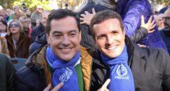 El presidente del Partido Popular, Pablo Casado (d), y el candidato a la presidencia de la Junta de Andalucía Juanma Moreno (i), en el mitin del Partido Popular a una semana de las elecciones, en Granada.