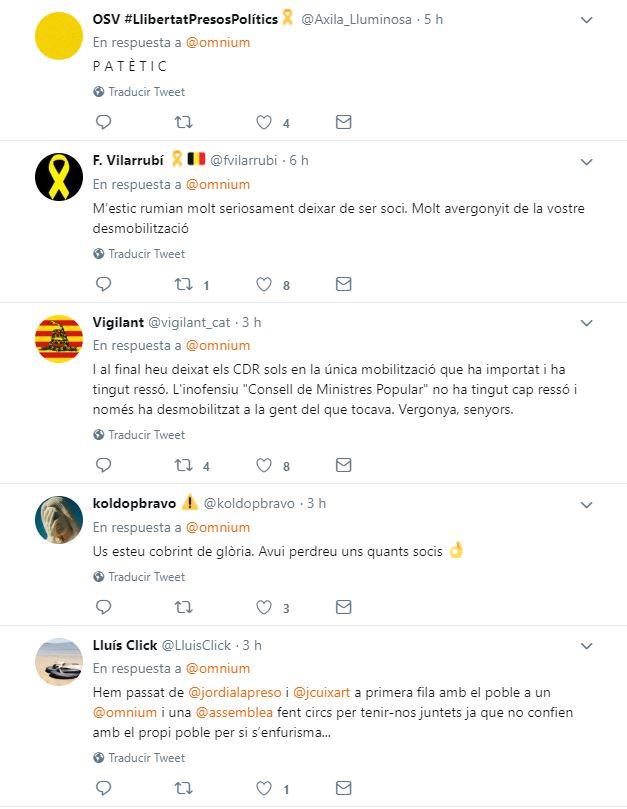 Respuestas de usuarios a los tweets de Òmnium sobre su particular consejo de ministros popular.