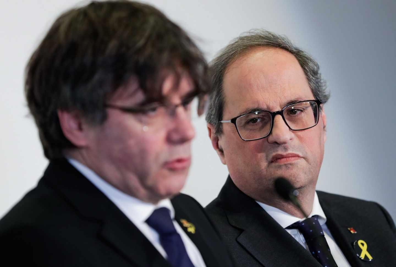 Carles Puigdemont y Quim Torra, durante una rueda de prensa en Bruselas.