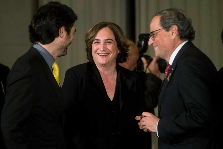 Jordi Puigneró , Ada Colau y Quim Torra, en la cena del Mobile.
