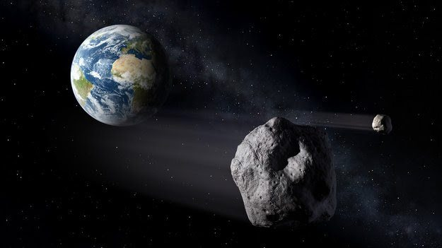Recreación de un asteroide pasando cerca de la Tierra.