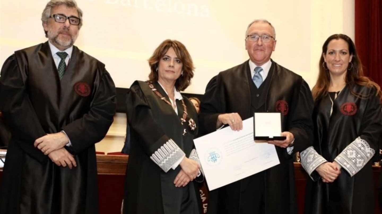 La ministra Delgado, junto a Jordi Pina (izda.)