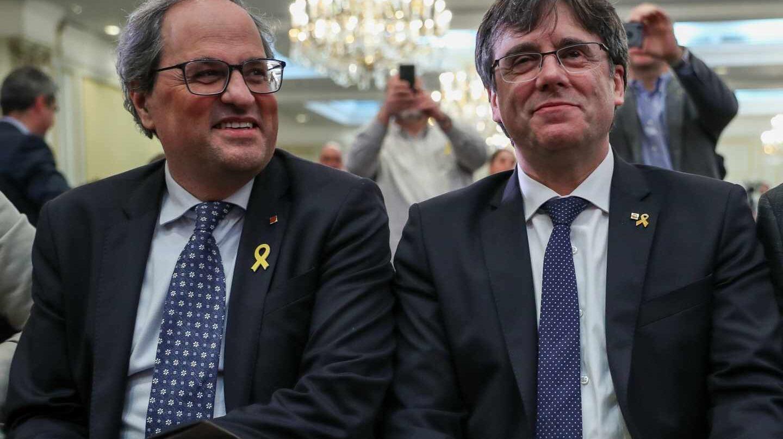 El presidente de la Generalitat de Cataluña, Quim Torra, junto a Carles Puigdemont.