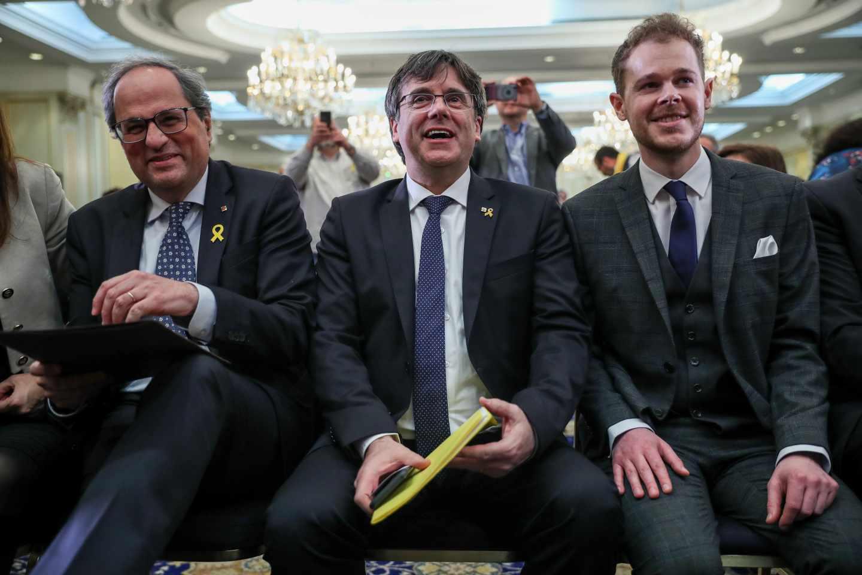 Quim Torra junto a Carles Puigdemont durante un acto en Bruselas.