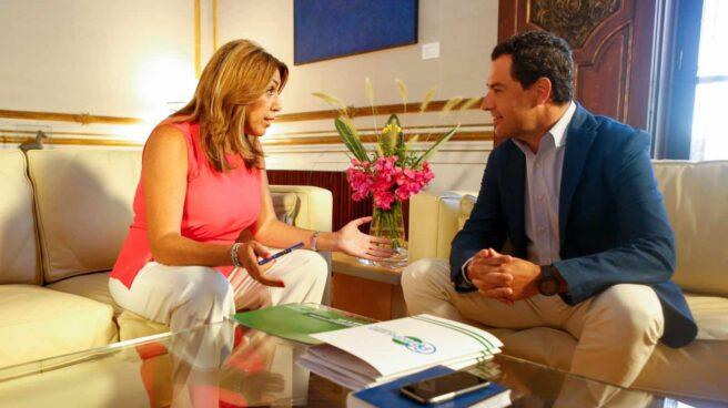 Susana Díaz y Juan Manuel Moreno, en una reunión en el Palacio de San Telmo durante la pasada legislatura.