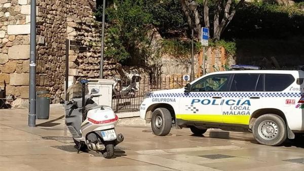 Coche y motocicleta de la Policía de Málaga