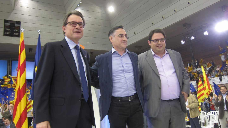 De izquierda a derecha, Artur Mas, Ramon Tremosa y Francesc Gambús en un acto en mayo de 2014.