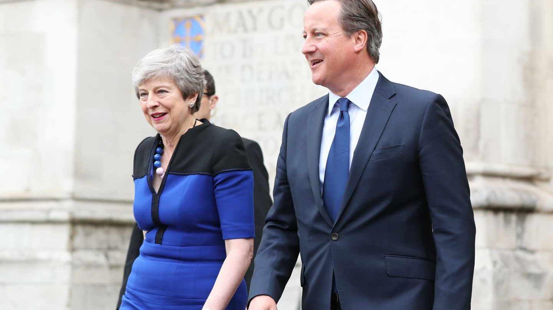 David Cameron, junto a Theresa May, su sucesora como primera ministra británica en un oficio religioso en la Abadía de Westminster.