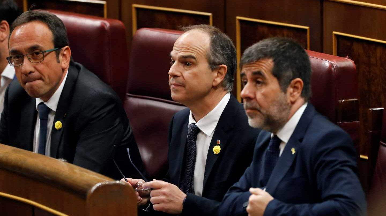 Los exconsejeros catalanes Josep Rull y Jordi Turull y el líder de ANC, Jordi Sànchez.