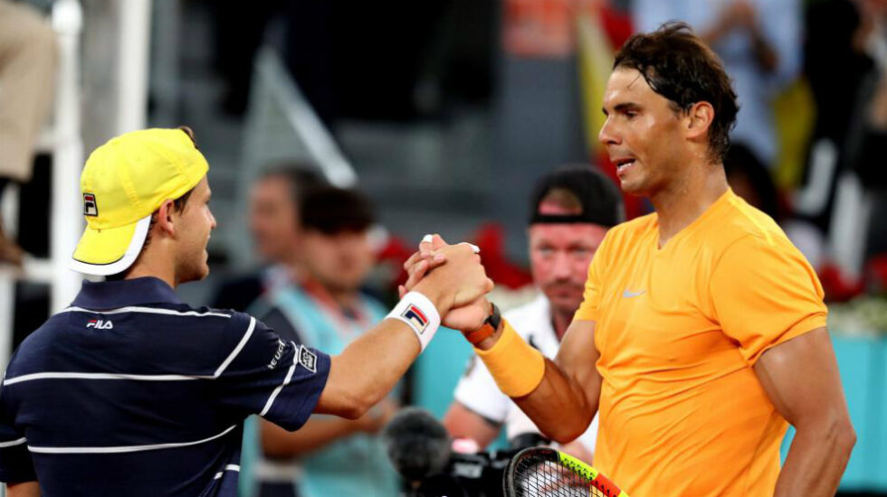 Nadal y Schwartzman se saludan tras un partido en la Caja Mágica