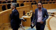 Los ministros Grande-Marlaska y Pablo Iglesias, en el Senado.