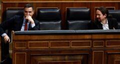 Pedro Sánchez y Pablo Iglesias, en sus escaños del Congreso durante una reciente sesión de control al Gobierno.