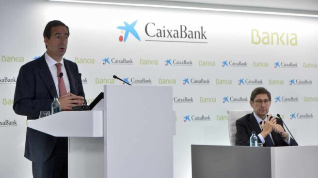 El presidente de Bankia, José Ignacio Goirigolzarri, y el consejero delegado de CaixaBank, Gonzalo Gortázar, presentan la nueva entidad.