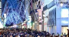 Vista general de la madrileña calle de Preciados este domingo por la tarde.