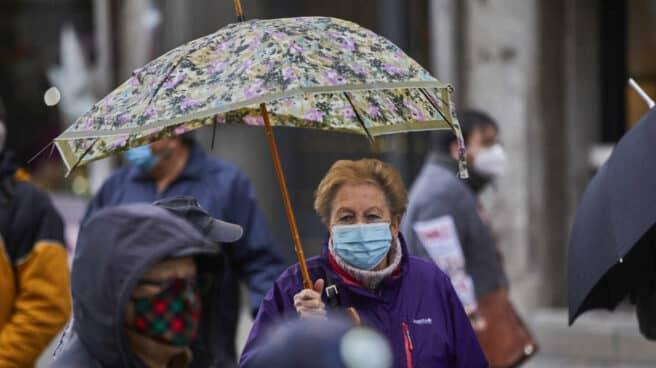Una mujer participa en la manifestación contra la reforma de pensiones.