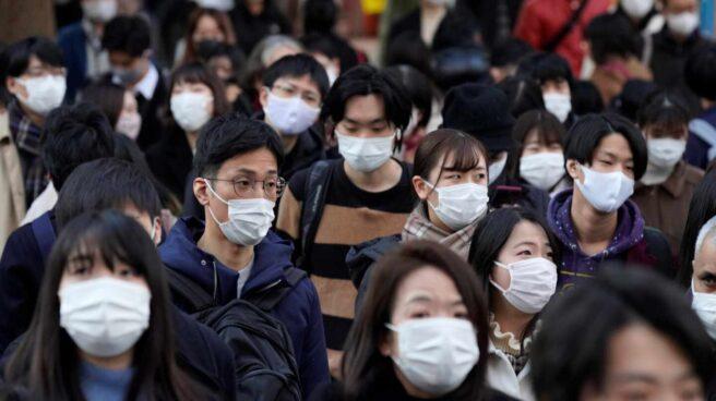 Ciudadanos de Tokio (Japón) con mascarilla.