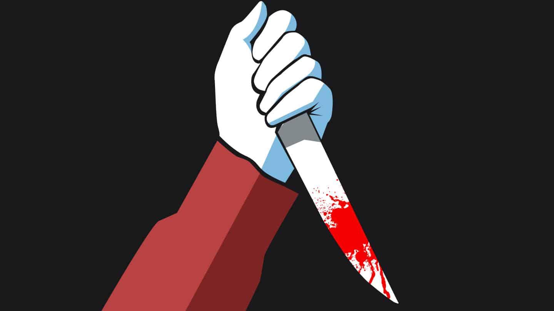 Imagen de una mano apuñalando