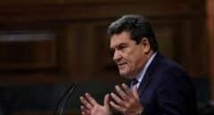 El ministro de Inclusión, Seguridad Social y Miraciones, José Luis Escrivá, durante su intervención en el pleno del Congreso de los Diputados.