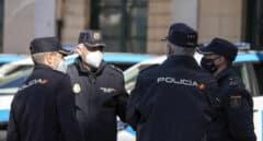 Un grupo de policías nacionales en acto de servicio durante la pandemia.