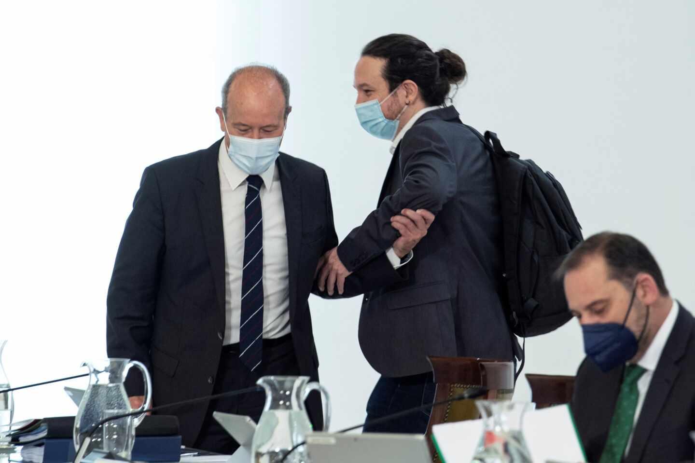 Juan Carlos Campo y Pablo Iglesias, en el Consejo de Ministros.