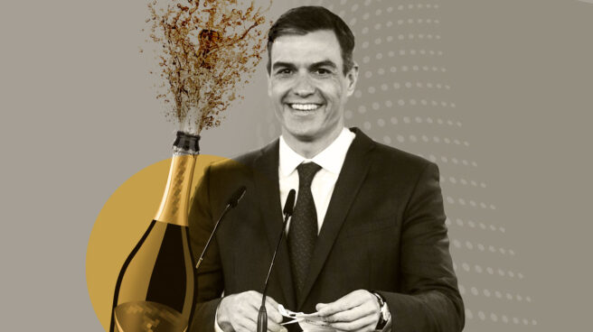 Imagen de Pedro sánchez al lado de una botella de Champagne