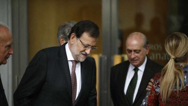 El expresidente del Gobierno Mariano Rajoy y el que fuera ministro del Interior, Jorge Fernández Díaz.