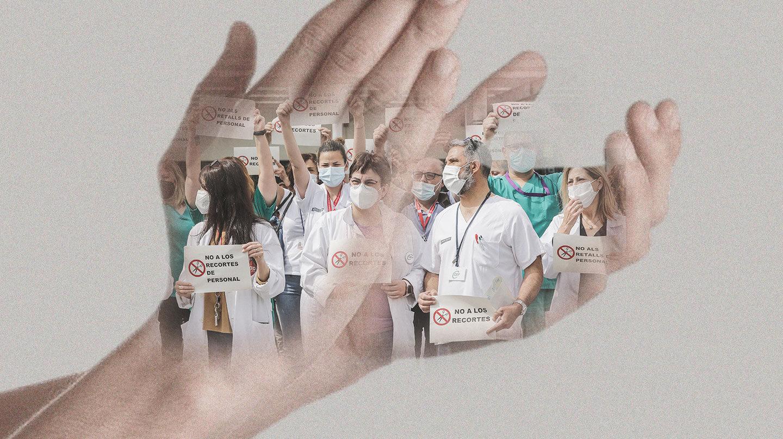 Manos aplaudiendo con Sanitarios en protesta sobre la imagen