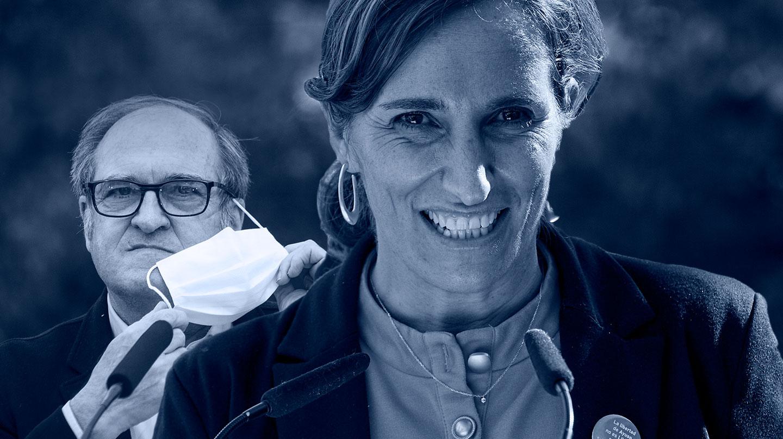 Imagen de Mónica García en primer plano y Gabilondo detrás quitándose la mascarilla